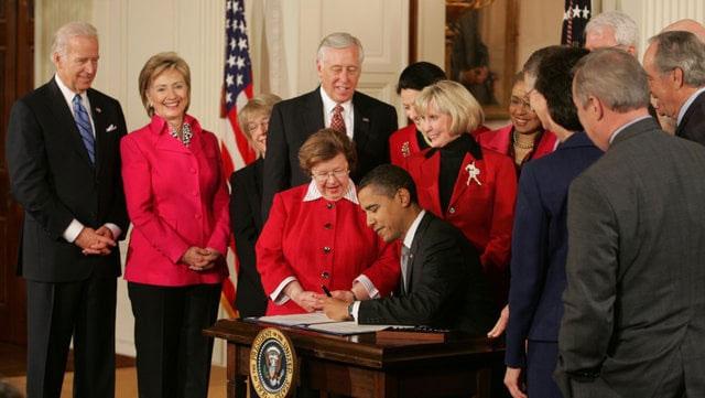 Signs his first legislation